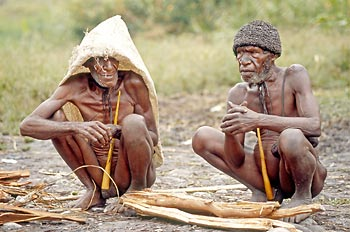 Two Dani men selling wood