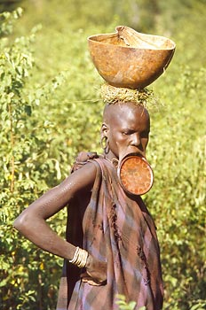 Mursi woman with a kalabash on her head